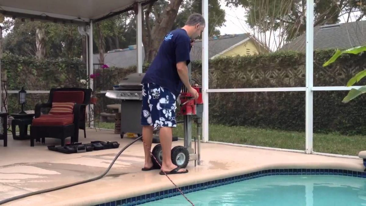 Drilling holes for pool safety fence